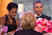 United States President Barack Obama and First Lady Michelle Obama eat dinner with recipients of the Medal of Freedom at the Smithsonian National Museum of American History on November 20, 2013 in Washington, D.C.<br /> Credit: Kevin Dietsch / Pool via CNP