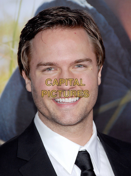 "SCOTT PORTER .at the Screen Gems' L.A. Premiere of ""Dear John"" held at The Grauman's Chinese Theatre in Hollywood, California, USA, February 1st 2010.   .arrivals portrait headshot black tie white shirt smiling .CAP/RKE/DVS.©DVS/RockinExposures/Capital Pictures."