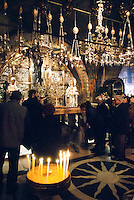 The Church of the Holy Sepulchre in the Old City of Jerusalem was first built by Emperor Constantine I in the fourth century. The present church was built by the Crusaders in the 12th century. The stairs just inside the entrance leads to Calvary (Golgotha) is the hillock traditionally regarded as where the Crucifixion of Jesus took place. The main altar contains The Rock of Calvary (12th Station of the Cross). Beneath the altar there is a hole said to be the place where the cross was raised.