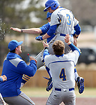 SIOUX FALLS, SD: Gus Steiger #3 from South Dakota State University is mobbed by teammates after driving home the winning run against North Dakota State University in the bottom of the ninth inning Thursday in Sioux Falls. (Dave Eggen/Inertia)