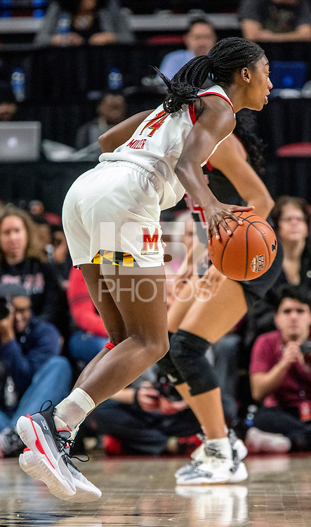 COLLEGE PARK, MD - FEBRUARY 9: Diamond Miller #14 of Maryland moves up court during a game between Rutgers and Maryland at Xfinity Center on February 9, 2020 in College Park, Maryland.