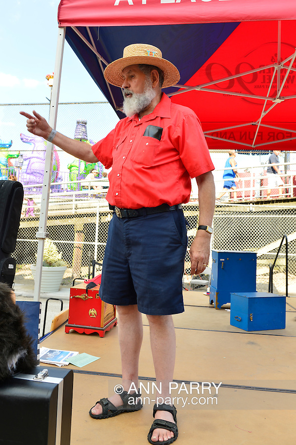 Brooklyn, New York, USA. 10th August 2013.  Organ grinder VINCENT MORGAN, an AMICA member, entertained visitors during the 3rd Annual Coney Island History Day celebration.
