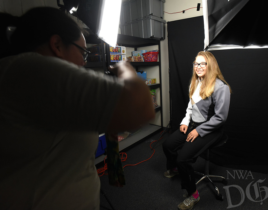 NWA Democrat-Gazette/FLIP PUTTHOFF <br />FITTING OCCASION<br />Brynn Arnao (cq) has her picture taken at Bentonville High School on Tuesday Aug. 7 2018 by band mom Kristie Floyd after Arnao received her band uniform. Band students tried on their uniforms for proper fit, then had their pictures taken for the band yearbook.