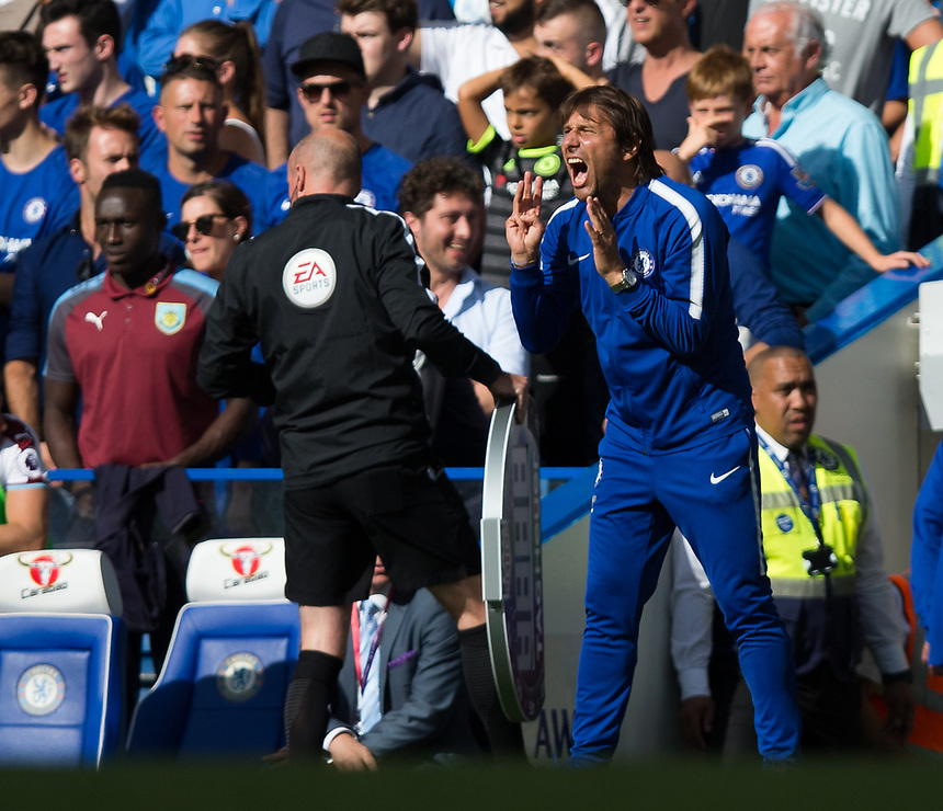 Chelsea manager Antonio Conte shouts instructions to his team from the dug-out <br /> <br /> Photographer Craig Mercer/CameraSport<br /> <br /> The Premier League - Chelsea v Burnley - Saturday August 12th 2017 - Stamford Bridge - London<br /> <br /> World Copyright &copy; 2017 CameraSport. All rights reserved. 43 Linden Ave. Countesthorpe. Leicester. England. LE8 5PG - Tel: +44 (0) 116 277 4147 - admin@camerasport.com - www.camerasport.com