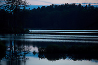 A night view of Tully Lake at Tully Lake Campground near Royalston, Massachusetts, USA.