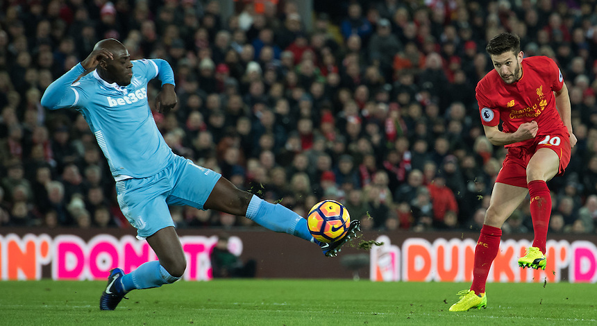 Liverpool's Adam Lallana's shot is blocked by Stoke City's Bruno Martins Indi<br /> <br /> Photographer Terry Donnelly/CameraSport<br /> <br /> The Premier League - Liverpool v Stoke City - Tuesday 27th December 2016 - Anfield - Liverpool<br /> <br /> World Copyright &copy; 2016 CameraSport. All rights reserved. 43 Linden Ave. Countesthorpe. Leicester. England. LE8 5PG - Tel: +44 (0) 116 277 4147 - admin@camerasport.com - www.camerasport.com