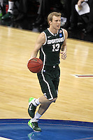 Michigan State Spartans guard Austin Thornton #13 brings the ball up court during the second round game of the NCAA Basketball Tournament at St. Pete Times Forum on March 17, 2011 in Tampa, Florida.  UCLA defeated Michigan State 78-76.  (Mike Janes/Four Seam Images)