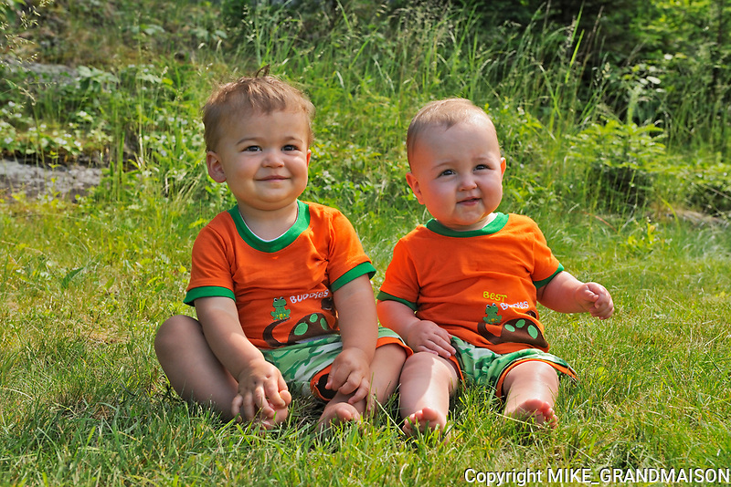 Baby boys sitting together as best friends<br />Whiteshell Provincial Park<br />Manitoba<br />Canada