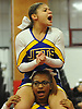Krystina Centeno, top, and Jaden Forteau of East Meadow perform during the varsity segment of the Freeport Devil Winter Cheerleading Competition at Freeport High School on Sat, Dec. 16, 2017.