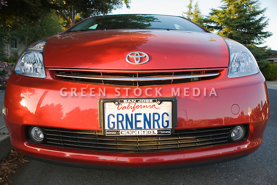 A front view of Toyota Prius with a 'GRNENRG' (Green Energy) license plate. Mountain View, California, USA