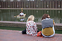 Ragnar Kjartansson's SECOND MOVEMENT, Barbican Lakeside.  To coincide with the exhibition in the Art Gallery, Kjartansson has conceived a new work of a mirrored scene of movement and symmetry, entitled SECOND MOVEMENT (2016), for the Barbican Lakeside every Saturday and Sunday. In a theatrical reality, two women in quintessential Edwardian costume row their boat on the Barbican Lakeside embracing in a never-ending kiss. Picture shows: Carly Halse &  Emmanuela Rahil Lia.