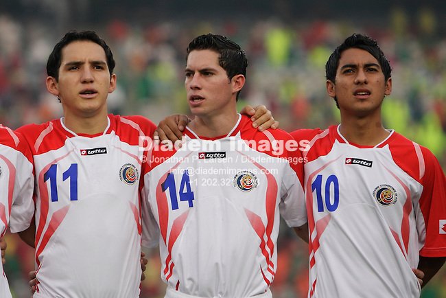 CAIRO - OCTOBER 16:   Cost Rican players Diego Madrigal (11), Bryan Oviedo (14) and Diego Estrada (10) line up for the national anthem prior to the FIFA U-20 World Cup soccer third place match against Hungary October 16, 2009 at Cairo International Stadium in Cairo, Egypt.    (Photograph by Jonathan P. Larsen)