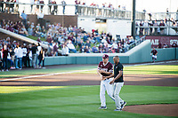 Super Bulldog Weekend: Baseball vs Arkansas at Dudy Noble Field.  First pitch with coach.<br />  (photo by Megan Bean / &copy; Mississippi State University)