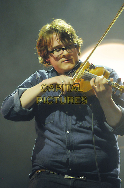 Ross Holmes of Mumford & Sons.performs on stage at Copps Coliseum,  Hamilton, Ontario, Canada, .26th October 2011..music live gig concert performing half length playing violin glasses blue shirt .CAP/ADM/BPC.©Brent Perniac/AdMedia/Capital Pictures.