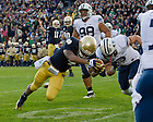 Oct. 20, 2012; Running back George Atkinson III stretches across the goal line to put Notre Dame ahead 17-14 in the fourth quarter...Photo by Matt Cashore.