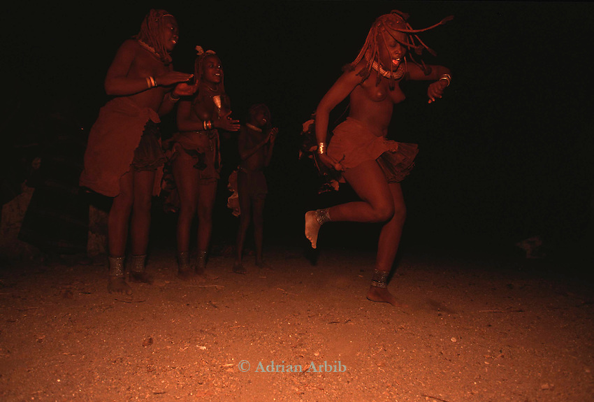 Himba  Girls doing a traditional dance , Northern Namibia.
