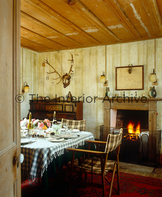 A table is laid for dinner in the cosy dining room