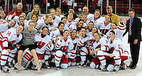 The Badger women's hockey team poses with the WCHA 1st place trophy, as the University of Wisconsin women's hockey team tops North Dakota 8-4 on Sunday, 2/13/11, at the Kohl Center in Madison, Wisconsin