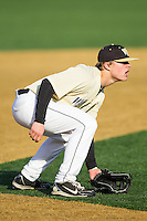 Wake Forest Demon Deacons third baseman Jimmy Redovian (23) on defense against the Marshall Thundering Herd at Wake Forest Baseball Park on February 17, 2014 in Winston-Salem, North Carolina.  The Demon Deacons defeated the Thundering Herd 4-3.  (Brian Westerholt/Four Seam Images)
