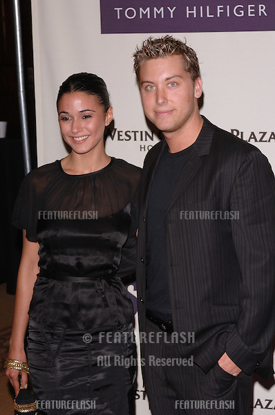 "NSync star LANCE BASS & girlfriend actress EMMANUELLE CHRIQUI at the 12th Annual Race to Erase MS Gala themed ""Rock & Royalty to Erase MS"" at the Century Plaza Hotel..April 22, 2005  Beverly Hills, CA..© 2005 Paul Smith / Featureflash"