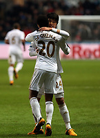 Saturday 19 January 2013<br /> Pictured: Jonathan de Guzman of Swansea (FRONT) celebrating his goal with team mate Ki Sung Yueng.<br /> Re: Barclay's Premier League, Swansea City FC v Stoke City at the Liberty Stadium, south Wales.