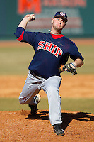 Relief pitcher Jimmy Miller #8 of the Shippensburg Red Raiders in action against the Catawba Indian at Newman Park on February 12, 2011 in Salisbury, North Carolina.  Photo by Brian Westerholt / Four Seam Images