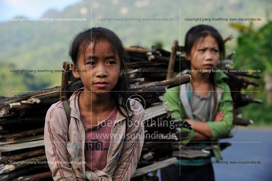 Lao PDR, children carry firewoods / Laos, Kinder tragen Feuerholz