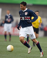 Brian Ching dribbles the ball at Pizza Hut Park in Frisco, Texas, Sunday, Feb. 19, 2005.  USA won 4-0.