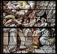 The Annunciation, with the Angel Gabriel announcing to Mary that she will have a baby, and God in heaven sending his holy spirit, from the Life of the Virgin and the Childhood of Christ grisaille stained glass window with silver and gold on white glass, 1545, by the School of Fontainebleau, in the South chapel choir of the Collegiate Church of Saint-Gervais-Saint-Protais, built 12th to 16th centuries in Gothic and Renaissance styles, in Gisors, Eure, Haute-Normandie, France. The church was consecrated in 1119 by Calixtus II but the nave was rebuilt from 1160 after a fire. The church was listed as a historic monument in 1840. Picture by Manuel Cohen