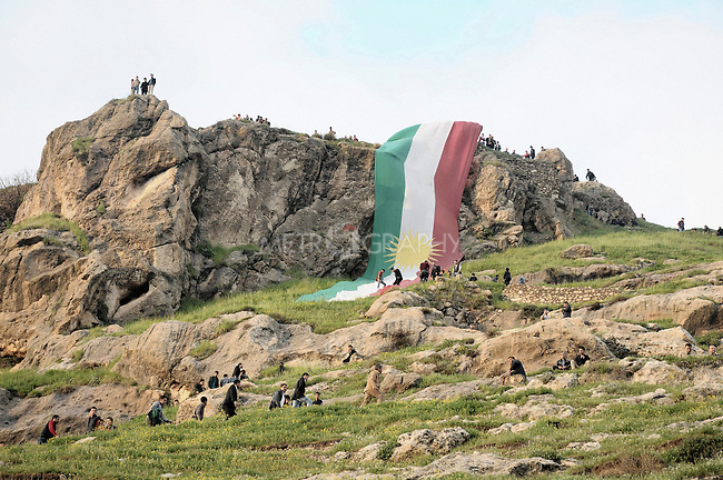 20/03/15 -- Akre, Iraq -- A Kurdish flag is seen on top of Akre mountains.