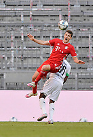 13th June 2020, Allianz Erena, Munich, Germany; Bundesliga football, Bayern Munich versus Borussia Moenchengladbach; Benjamin Pavard (Bayern) wins the header from Breel Embolo (Borussia Mönchengladbach)