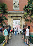 VMI Vincentian Heritage Tour: The Rev. Edward Udovic, C.M., leads members of the Vincentian Mission Institute cohort as they walk around the outside of the Priory of St Lazare, (107 Rue du Faubourg Saint Denis), Thursday, June 23, 2016, during their tour of Vincentian sites in Paris.  The site was home for Vincent de Paul in the latter part of his life and the area also includes the Gare du Nord and the Church of St Vincent de Paul. (DePaul University/Jamie Moncrief)