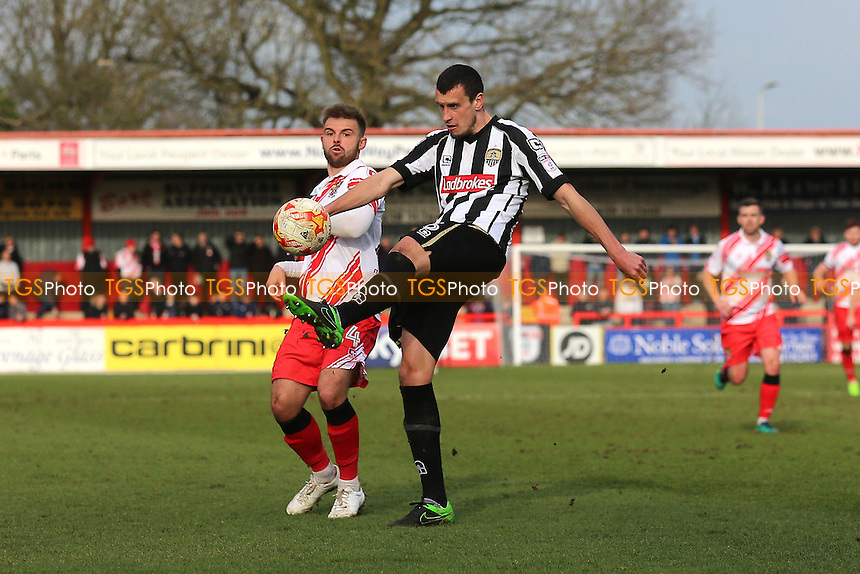 Haydn Hollis of Notts County clears from Matthew Godden of Stevenage during Stevenage vs Notts County, Sky Bet EFL League 2 Football at the Lamex Stadium on 4th March 2017