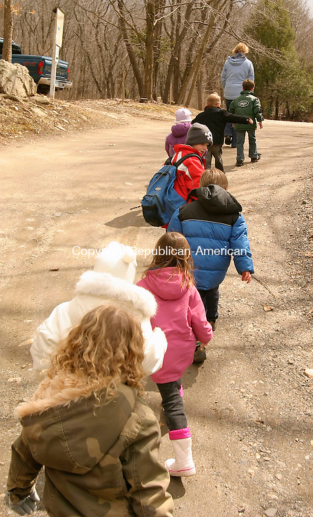 WOODBURY, CT--05 APRIL 2007--040507JS07-Students follow instructor Diane Parmalee to the vernal pond at Flanders Nature Center in Woodbury to look for frogs during Thursday's Children's Farming program. FOR COUNTRY LIFE<br /> Jim Shannon / Republican-American