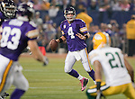 Minnesota Vikings quarterback Brett Favre (4) looks for a receiver during an NFL football game against the Green Bay Packers at the Hubert H. Humphrey Metrodome on October 5, 2009 in Minneapolis, Minnesota. The Vikings won 30-23. (AP Photo/David Stluka)