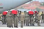 The bodies of four Italian soldiers killed in Afghanistan are carried by comrades at the Ciampino airport in Rome on October 11, 2010.