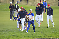 Bryson DeChambeau (Team USA) and Alex Noren (Team Europe) walking down the 18th fairway during the Sunday Singles of the Ryder Cup, Le Golf National, Ile-de-France, France. 30/09/2018.<br /> Picture Thos Caffrey / Golffile.ie<br /> <br /> All photo usage must carry mandatory copyright credit (© Golffile | Thos Caffrey)