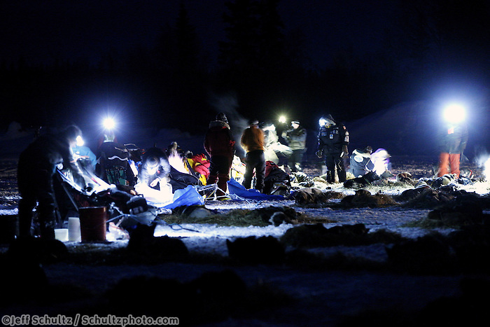 Volunteers check in mushers and teams at the Finger Lake checkpoint early Monday, March 4, 2013.