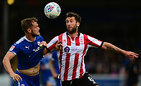 Chesterfield's Scott Wiseman vies for possession with Lincoln City's Ollie Palmer<br /> <br /> Photographer Chris Vaughan/CameraSport<br /> <br /> The EFL Sky Bet League Two - Lincoln City v Chesterfield - Saturday 7th October 2017 - Sincil Bank - Lincoln<br /> <br /> World Copyright &copy; 2017 CameraSport. All rights reserved. 43 Linden Ave. Countesthorpe. Leicester. England. LE8 5PG - Tel: +44 (0) 116 277 4147 - admin@camerasport.com - www.camerasport.com