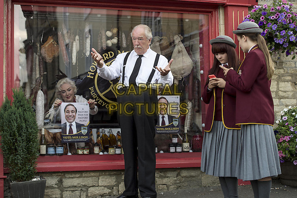 Michael Gambon, Lauren Downing<br /> in The Casual Vacancy (2015) <br /> *Filmstill - Editorial Use Only*<br /> CAP/FB<br /> Image supplied by Capital Pictures