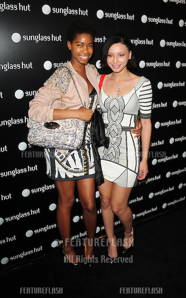 Tallulah Adeyemi and Leah Weller attending the launch party for the new Sunglasses Hut Store on Oxford Street, London. 29/04/2010  Picture by: Simon Burchell / Featureflash
