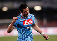 Naples's  Blerim Dzemailicelebrates after scoring against Genoa during their Italian Serie A soccer match at the San Paolo  stadium in Naples April 7, 2013