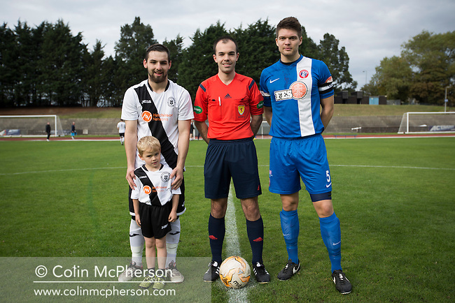 Club captains and mascot pictured with the referee together at Meadowbank Stadium in Edinburgh, before Edinburgh City (in white) played host to Spartans in a Lowland League fixture. The host won the match 1-0 with a late goal by Ousman See, despite playing for the last 30 minutes with 10 men after Ross Allum was sent off. The wind kept the reigning champions side clear at the top of the league.