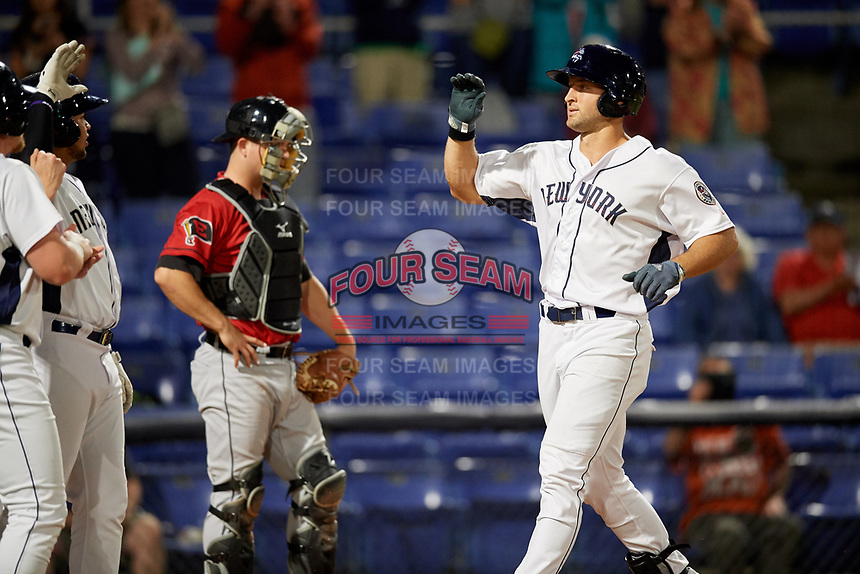 Binghamton Rumble Ponies left fielder Tim Tebow (15) celebrates at home plate in front of catcher Jake Rogers (7) after hitting a sixth inning home run during a game against the Erie SeaWolves on May 14, 2018 at NYSEG Stadium in Binghamton, New York.  Binghamton defeated Erie 6-5.  (Mike Janes/Four Seam Images)