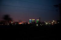 Evening landscape view from a train of urban city buildings near the Sānménxiá Shì Húbīn District in Hénán Province.  © LAN
