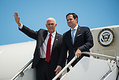 In this photo released by the National Aeronautics and Space Administration (NASA) United States Vice President Mike Pence waves next to US Senator Marco Rubio (Republican of Florida), after they arrived on Air Force Two at the Shuttle Landing Facility (SLF) to highlight innovations made in America and tour some of the public/private partnership work that is helping to transform Kennedy Space Center (KSC) into a multi-user spaceport on Thursday, July 6, 2017 in Cape Canaveral, Florida. <br /> Mandatory Credit: Aubrey Gemignani / NASA via CNP
