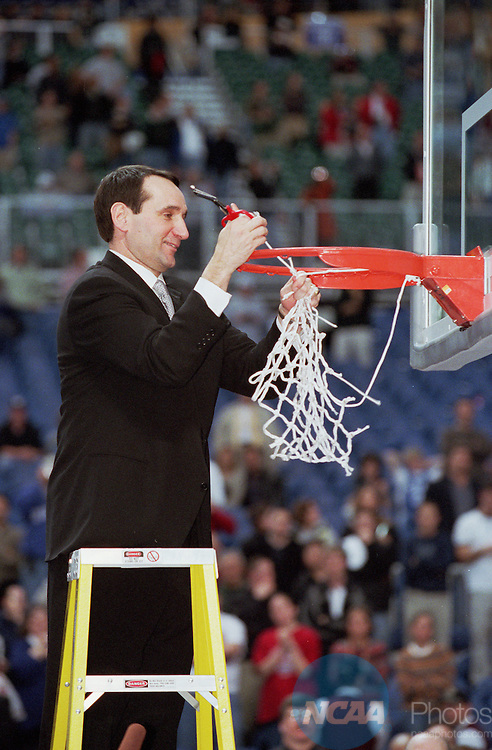 02 APR 2001:  Duke University head coach Mike Krzyzewski cuts down the net after defeating Arizona in the NCAA Men's Basketball Final Four Championship game held in Minneaplois, MN at the Hubert H. Humphrey Metrodome. Duke defeated Arizona 82-72 for the championship. Ryan McKee/NCAA Photos