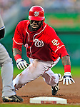 6 June 2009: Washington Nationals' outfielder Elijah Dukes dives safely back to first during a game against the New York Mets at Nationals Park in Washington, DC. The Nationals defeated the Mets 7-1, with Nats' starting pitcher John Lannan going the distance for his first career complete-game win. Mandatory Credit: Ed Wolfstein Photo