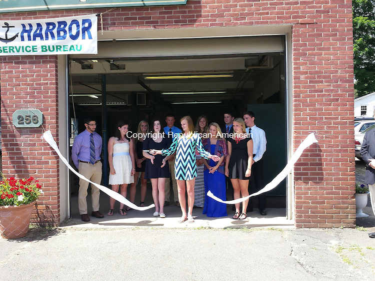 BURLINGTON, CT- 22 June 2014- 062214BJ02-- Hannah Doyle of Harwinton watches after she cut the ribbon opening the Safe Harbor's new space at the former Burlington fire station. The new space allows Safe Harbor, a group of Harwinton and Burlington high school students, to hold events. Safe Harbors was started two years ago for students who pledge to be substance free. Bruno Matarazzo Jr. Republican-American