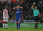 Marc Albrighton of Leicester City reacts to a yellow card during the English Premier League match at the Bet 365 Stadium, Stoke on Trent. Picture date: December 17th, 2016. Pic Simon Bellis/Sportimage
